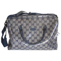 gucci coated monogram blue travel bag