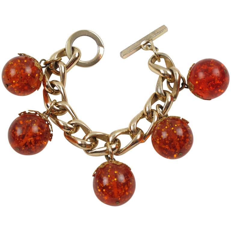 Orangeade Prystal Bakelite Bead Charm Bracelet with Gilt Chain 1