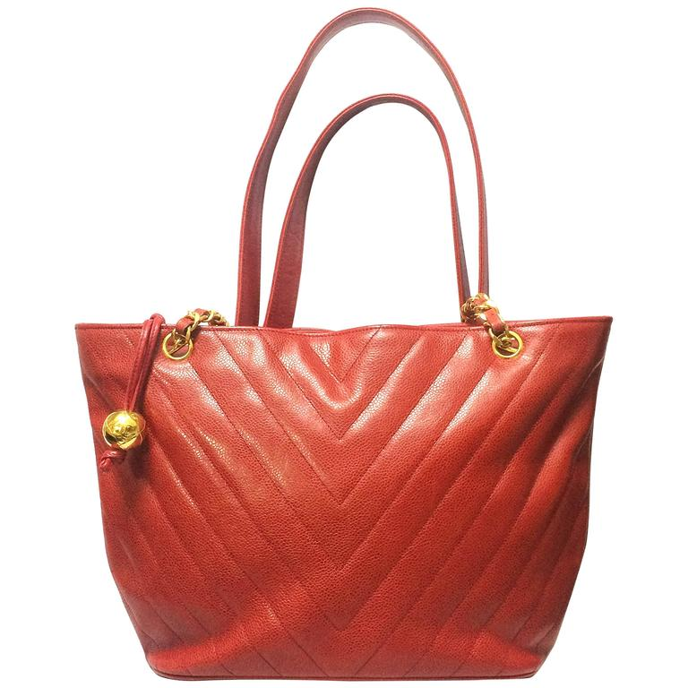 Vintage CHANEL red caviar v stitch, chevron style chain shoulder tote bag.