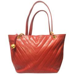 Vintage CHANEL red caviar v stitch, chevron style chain shoulder tote bag.
