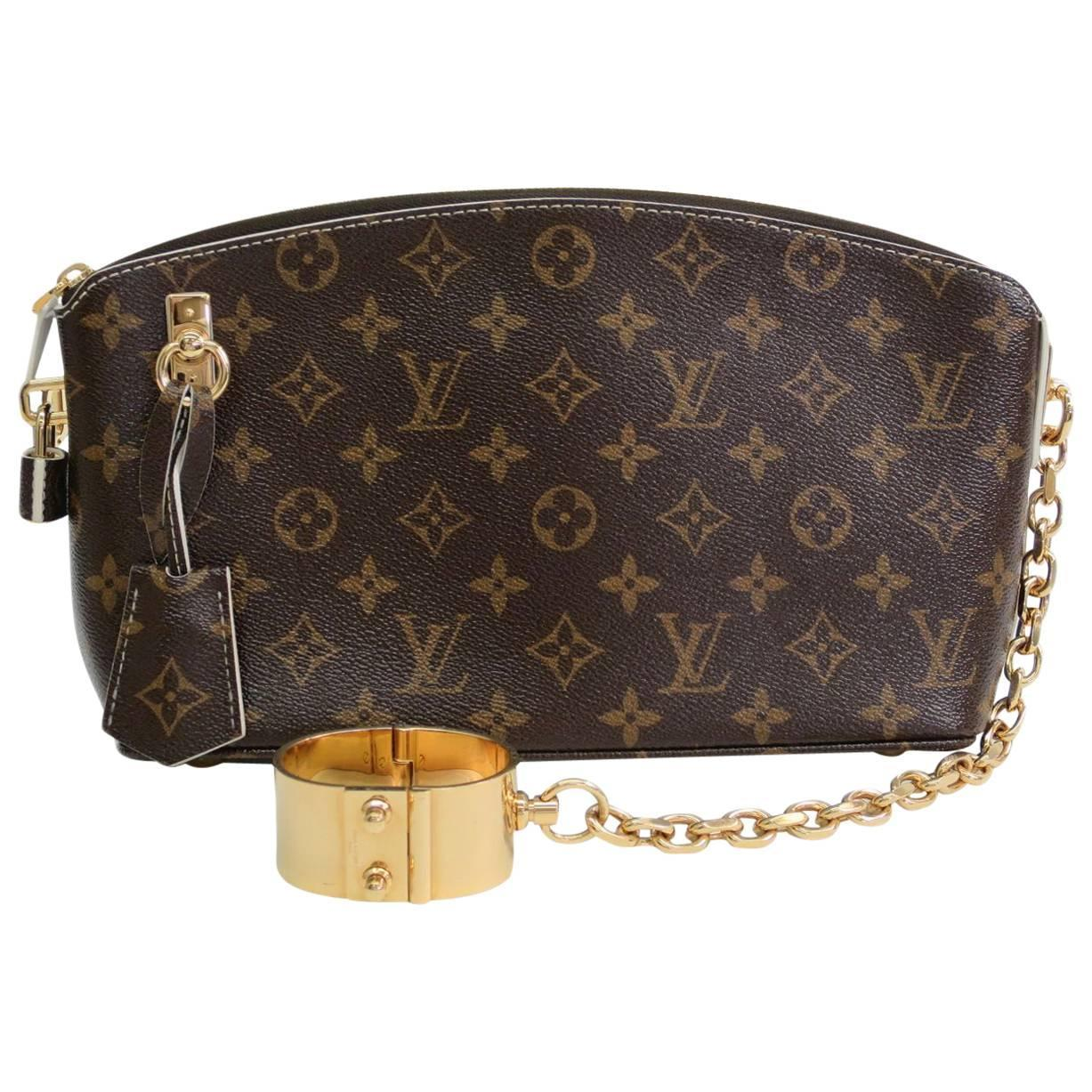 louis vuitton monogram canvas gold chain clutch cuff bag with all accessories at 1stdibs
