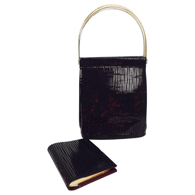 Cartier Trinity Burgundy stripe suede handbag & matching agenda