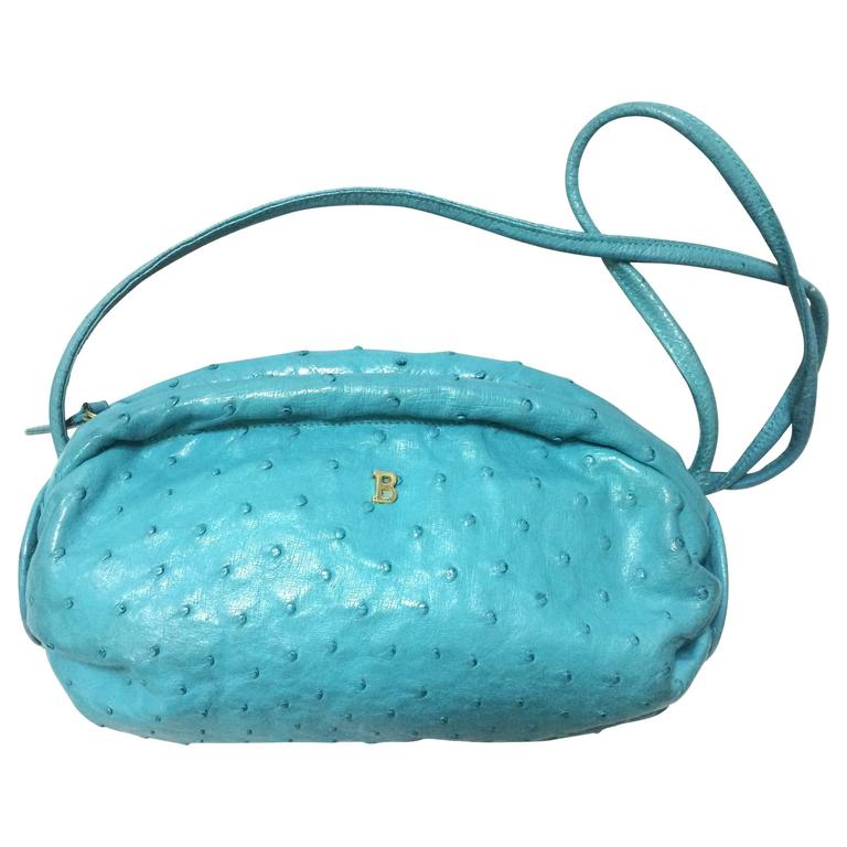 Vintage BALLY genuine dark milky blue ostrich leather drum mini shoulder bag.