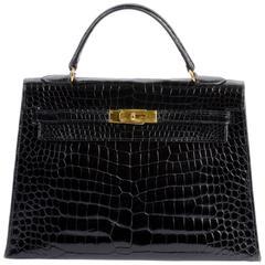 Hermes 32cm Shiny Black Crocodile Sellier Kelly Bag with Gold Hardware C 1950's