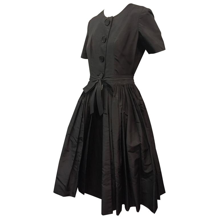 1950s Gustave Tassell Black Silk Cocktail Dress w Exposed Under-Skirt and Bow