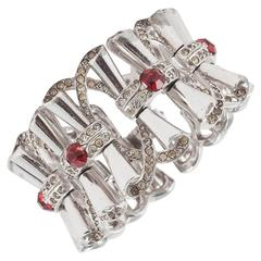 Fluid rhodium plated cocktail bracelet with clear and red paste accents, 1950s