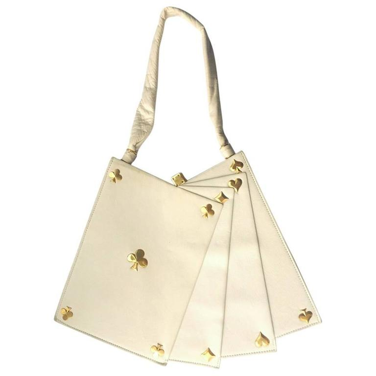 Anne-Marie of Paris white leather and gilt 'Hand of Cards' handbag.
