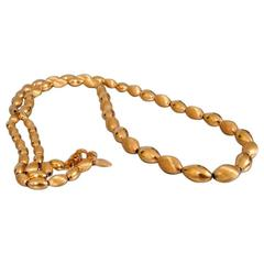 Vendome Long Graduated Gold Bead Necklace