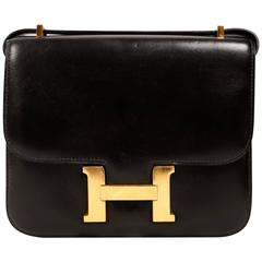 HERMES Constance 'mini' black leather with gold hardware 18cm