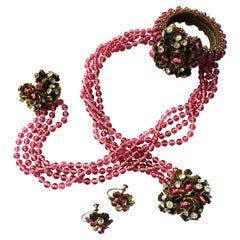 A cranberry glass and paste wrap around parure, Miriam Haskell, USA, 1930s.