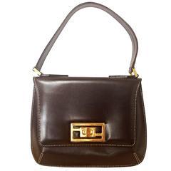 7b24d184bc ... Vintage FENDI genuine dark brown leather handbag with golden FF logo at  closure.