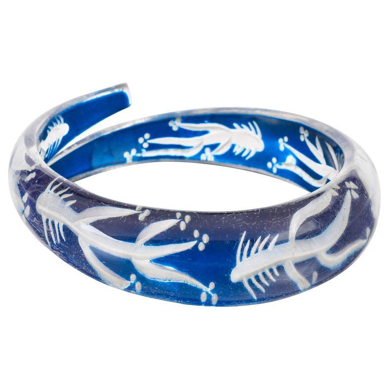 c.1930s-1940s Blue Plastic Lucite Reversed Handcarved Fish Bone Bangle Bracelet For Sale