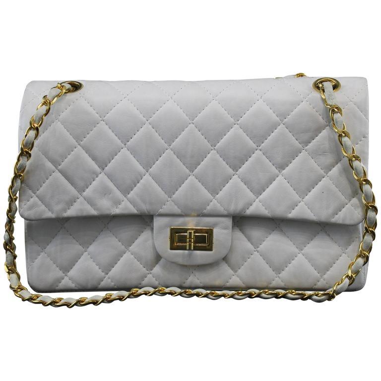 ea62621c1a53f3 Vintage 80's Chanel 2.55 Bag in White Letaher and Golden Hardware. size 10