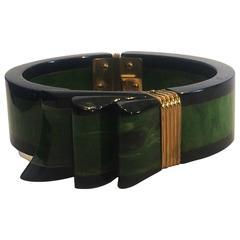Rare two colour bakelite hinged ribbon clamper bracelet