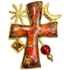Christian Lacroix Red/Orange Resin Inlaid Cross Gold Toned Sun and Moon Brooch