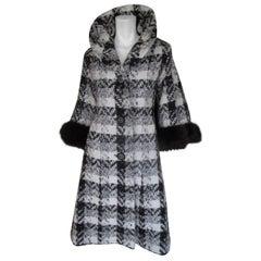 Stylish wool cape coat trimmed with black fox fur