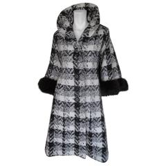 Stylish wool cape coat trimmed with black fox fur
