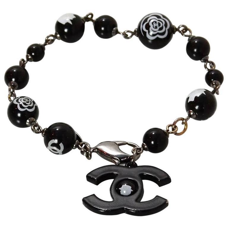 b162b3e49deded Chanel Black and White Camellia CC Bracelet For Sale at 1stdibs
