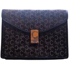 Vintage CELINE dark brown logo carriage jacquard clutch bag with leather pipings
