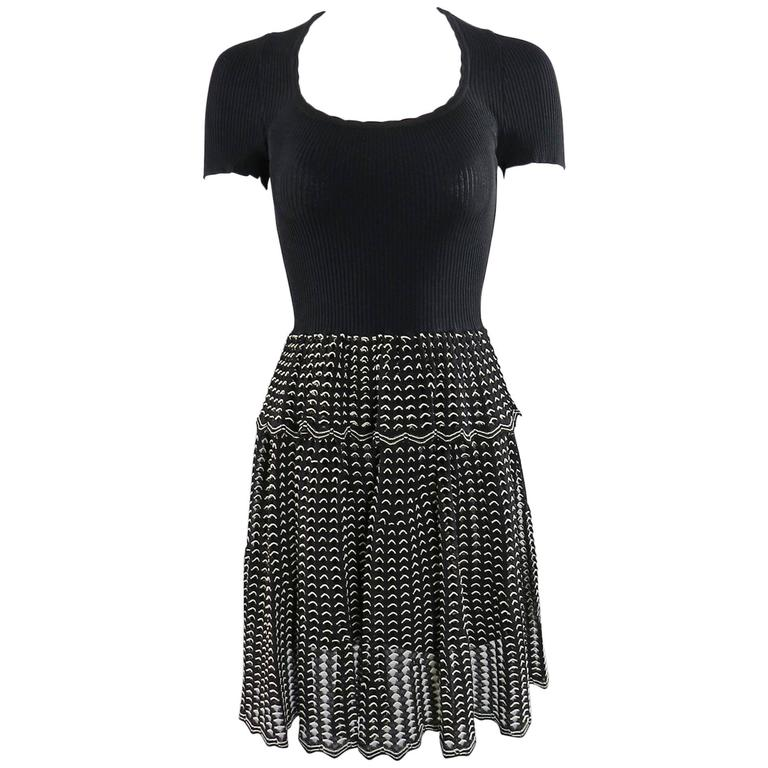 Alexander McQueen Black Ribbed Stretch Knit Peplum Dress For Sale
