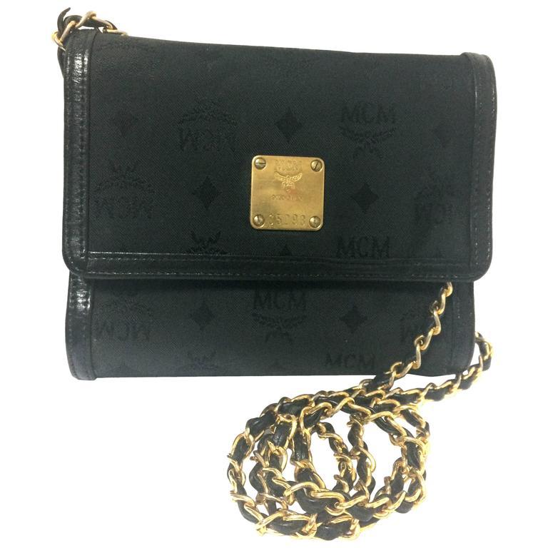 Vintage MCM black nylon monogram rare clutch shoulder bag with leather trimmings