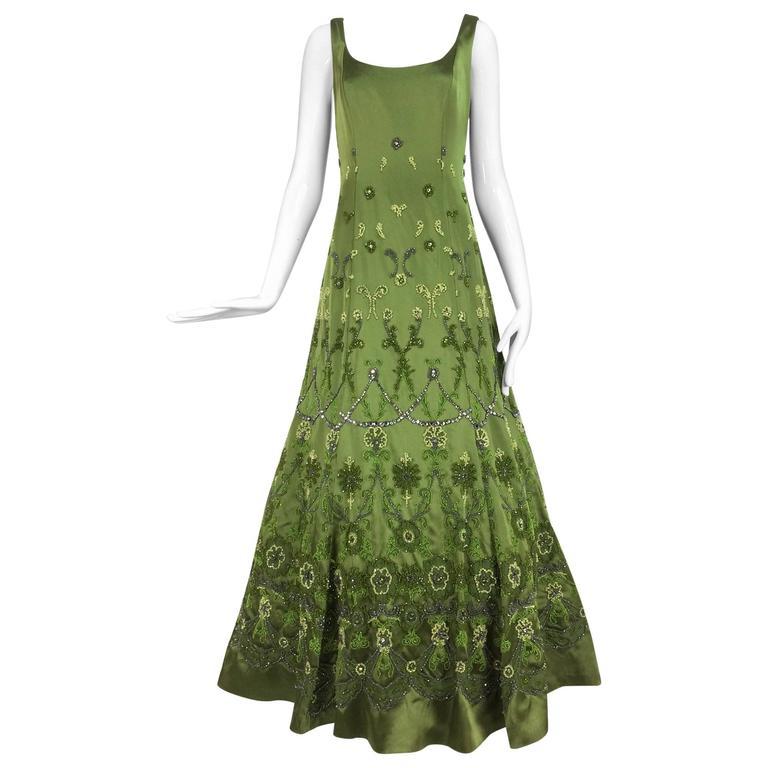 Randi Rahm green silk heavily hand beaded and rhinestone evening dress