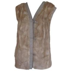 sleeveless mink fur vest trimmed with leather