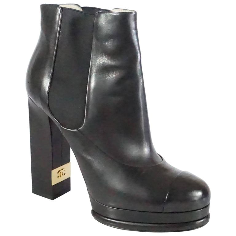 8973ba750ef9 Chanel Black Leather Platform Ankle Boots - 37.5 For Sale at 1stdibs