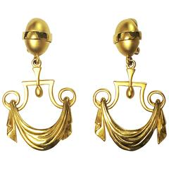 Vintage Karl Lagerfeld golden dangling earrings in drapery window curtain design