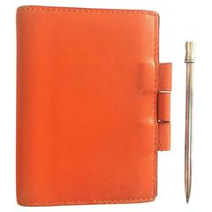 Vintage HERMES orange leather diary, schedule book cover PM with silver pencil