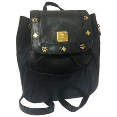 80's vintage MCM genuine leather black backpack with golden logo motifs. Unisex