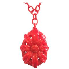 Art Deco heavily carved red bakelite pendant necklace on celluloid chain