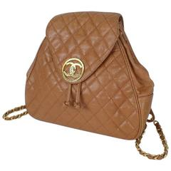 Vintage CHANEL quilted brown caviar leather backpack with gold chain straps.
