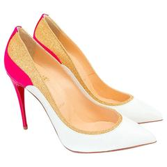 Christian Louboutin white patent pumps