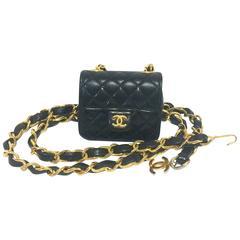 Vintage CHANEL black lambskin mini 2.55 bag charm chain leather belt with CC.