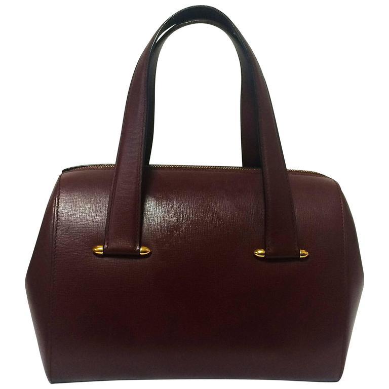Vintage Cartier classic wine, bordeaux leather handbag purse. Must de Cartier