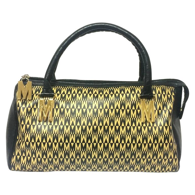 Vintage MOSCHINO black and ivory beige logo M print handbag, mini duffle bag.