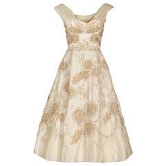 1950's Ceil Chapman Ivory Satin Rhinestone Metallic Floral Shelf-Bust Dress