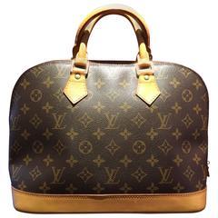 Monogramed Alma PM Handbag