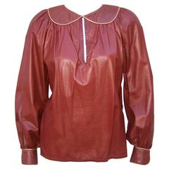 1970's Geoffrey Beene Oxblood Leather Smock Top With Gold Stitching