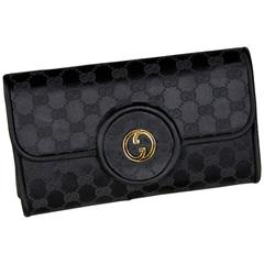 Gucci clutch monogram vintage 1970s canvas hand bag pochette black made in italy