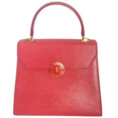 Vintage Valentino Garavani pink red epi leather handbag with round V logo motif.