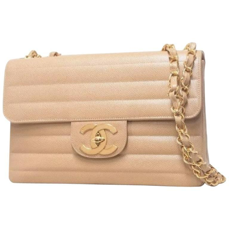 Vintage CHANEL beige 2.55 horizontal stitch large caviar leather shoulder bag. 1