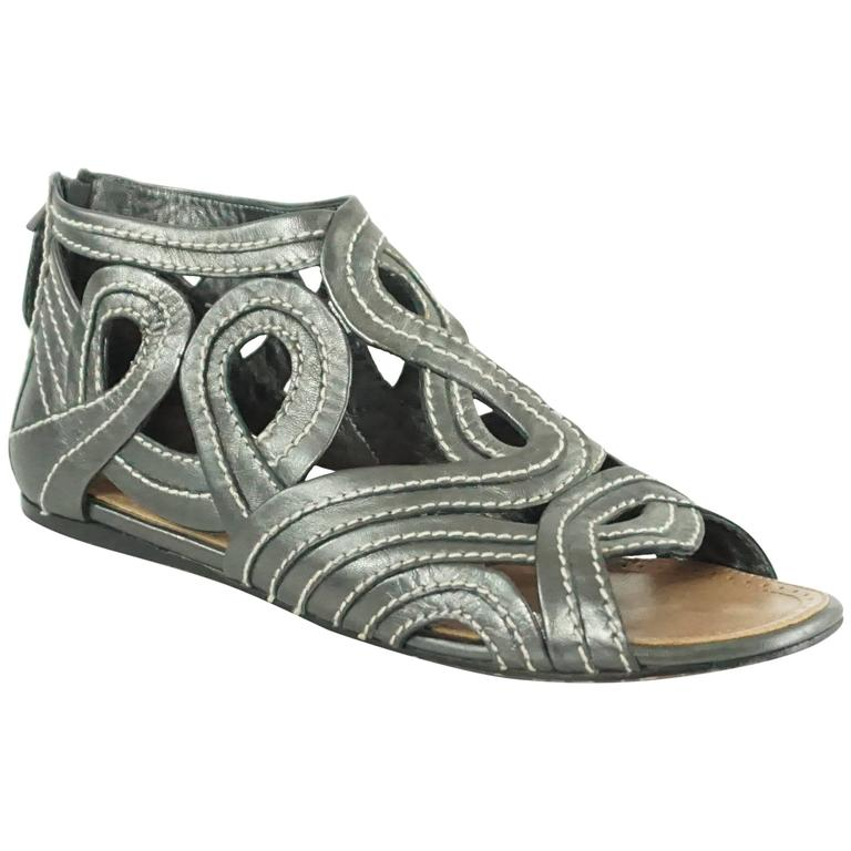 7d8e87ebfa0 Alaia Gunmetal Leather Gladiator Shoes - 37.5 For Sale at 1stdibs