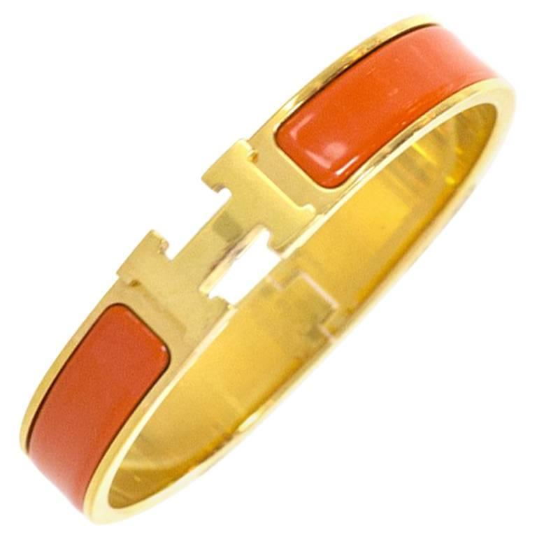 hermes orange enamel and gold h clic clac gm bangle