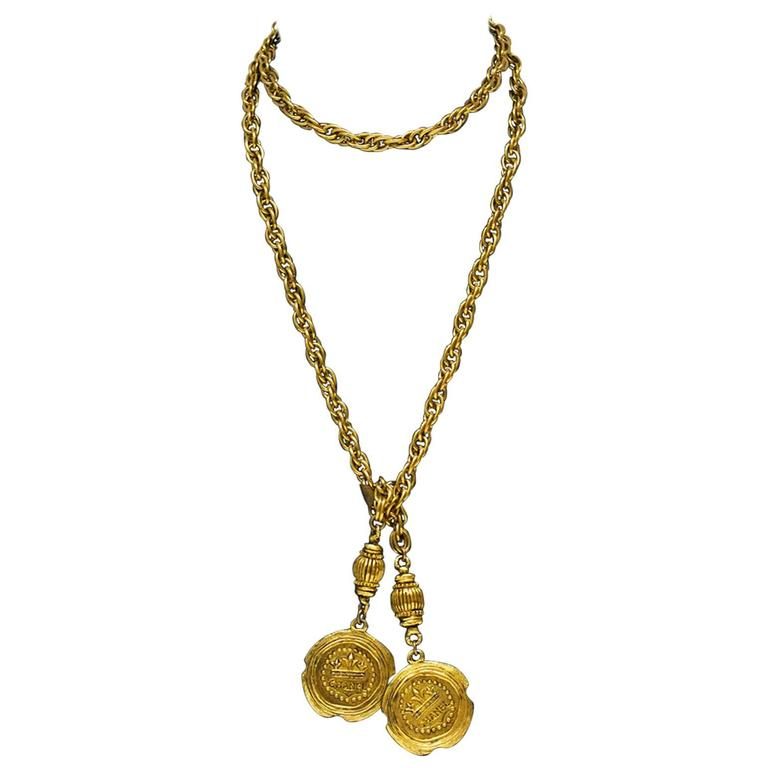 Late 1980s Chanel Long Gold Lariat Necklace with Coin Details  For Sale