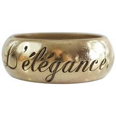 """Chanel Goldtone """"L'elegance, c'est la ligne"""" etched thick bangle - 2007P"""