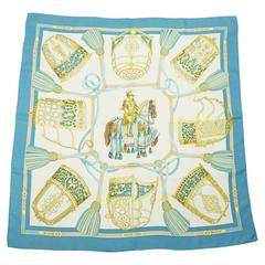 "Hermes Ivory, Gold, and Blue ""Les Muserolles"" Knight Print Scarf"