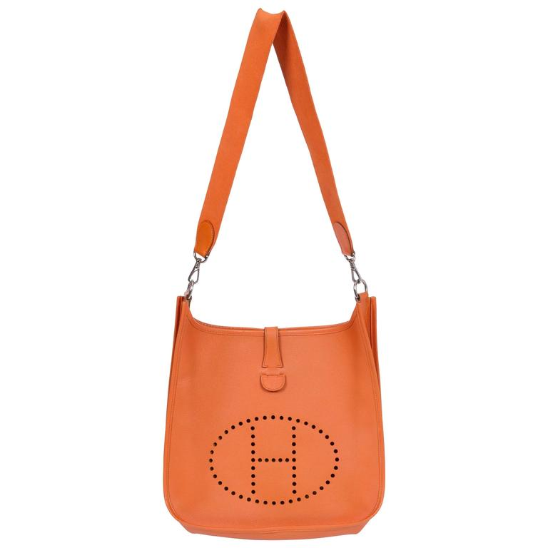 31fd84b221b Hermes Large Orange Vintage Evelyne Bag at 1stdibs