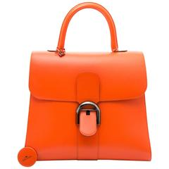 Delvaux Brillant Black Edition in mandarine